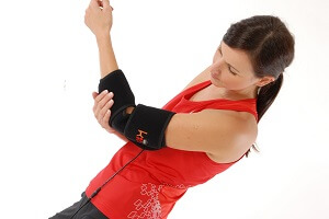 A Woman Wearing a King Brand Elbow BFST Wrap