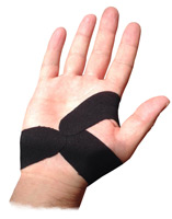 A hand that has been taped to supprt the area surrounding a Carpal Tunnel injury, to provide support and prevent re-injury
