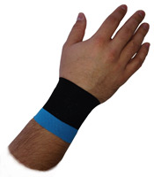 A wrist that has been taped with KB Support Tape to provide support for an Intersection Syndrome injury